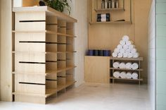 Stretch Yoga Studio features a pallet of plywood, brass and tiles Yoga Studio Design, Plywood, Shelving, Stretches, Tiles, Architecture, Room, Hospitality, Signage