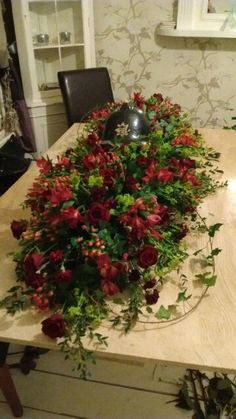 Double ended spray funeral flowers  Red roses ivy