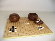 The Game Supply - Complete Go Game Set With Slotted Board, $134.95 (http://www.thegamesupply.com/complete-go-game-set-with-slotted-board/)