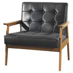 Tufted arm chair with a midcentury-inspired silhouette and exposed wood frame.   Product: ChairConstruction Material: