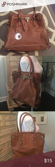 Shoulder bag Large (13 1/2w x 12 1/2 l) leather like shoulder bag with two different shoulder straps. Lots of room on the inside. Great condition. The only flaw I see is on one strap, as shown in last two pics. carolyn tucker Bags Shoulder Bags