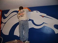 Fun way to decorate a child 39 s room handmade afigan on the for Denver broncos bedroom ideas