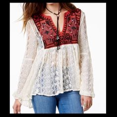 Free People Lace Embroidered Tunic A lace Free People tunic accented with an embroidered mesh panel. High-low hem and long sleeves. Sheer. NWT Free People Tops Tunics