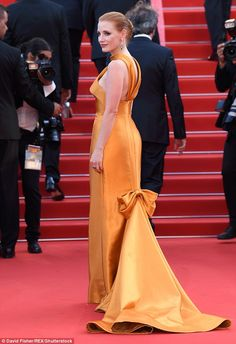 She means business:The back of the dress featured a low-set large bow and allowed the met...
