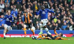 Lazar Markovic Photos Photos - Romelu Lukaku of Everton evades Lazar Markovic of Hull City during the Premier League match between Everton and Hull City at Goodison Park on March 18, 2017 in Liverpool, England. - Everton v Hull City - Premier League