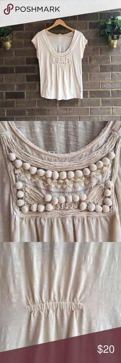 "Anthropologie C Keer Cream Top Made by C Keer, this Anthropologie top is the perfect shade of cream. Textured design on the neckline is classic. Sweet cotton balls add a touch of whimsy. Sweet beading adds a little sparkle. Small spot on shoulder (pictured) Approximate measurements lying flat: 18.5"" bust, 24.5"" length 10482 C. Keer Tops Tees - Short Sleeve"
