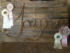 ANNA Easy sign with horse show rosettes, stained reclaimed boards, and manilla rope. Order custom color rosettes at http://www.luckypony.com/productcart/pc/viewPrd.asp?idProduct=28944