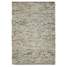 This rug has a little texture and would look great with the wall color. I think you would need a 7' x 10' to properly fill the space.