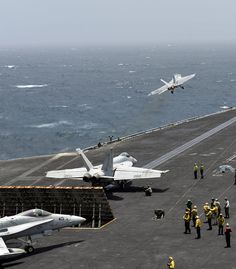 "NORTH ARABIAN SEA (July 22, 2013) - An F/A-18E Super Hornet assigned to the ""Argonauts"" of Strike Fighter Squadron (VFA) 147 takes off from the flight deck of the aircraft carrier USS Nimitz (CVN 68)."