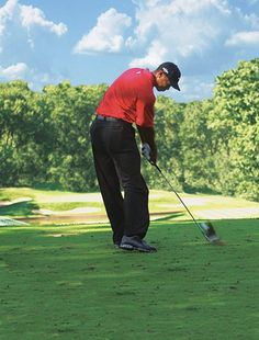 """According to Tiger Woods, it is integral to take a divot to ensure the best iron shot possible. To do this and strike the ball well, he advocates, """"Try shallowing out your backswing -- swinging a little more around you. That sets up a shallower angle into the ball and a long, thin divot. It also helps if you turn the knuckles of your top hand to the ground through impact. This is a clear sign that you're compressing the ball, trapping it between the clubface and the turf, which will result…"""