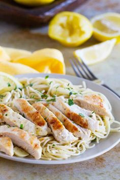 lemon chicken pasta A light lemon flavor is the star of this pasta dish with lemon and garlic scented pasta, topped with a slightly crispy lemon chicken. This Lemon Chicken Pasta is a weeknight winner! Lemon Garlic Pasta, Lemon Chicken Pasta, Garlic Sauce, Garlic Butter, Roasted Garlic, Garlic Bread, All You Need Is, Healthy Chicken Recipes, Cooking Recipes