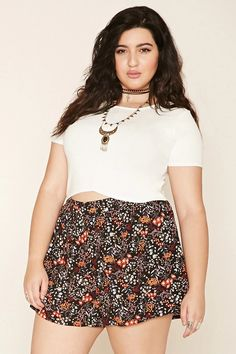Forever 21+ - A pair of shorts featuring an allover floral print, and an elasticized waist.