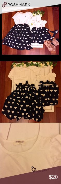 ❤️ Mommy & Me dresses - like new! ❤️ Mommy & Me dresses - super cute dresses like new, white and navy blue with hearts! 2 dresses- both worn one time. Like new, bought from PopReal, made in China. Mommy dress- size Medium, girl dress is size 100 cm (lifts like a 18 mo-2T, after washed). Both dresses have been through washer & dryer already and has shrunk a little. Dresses Casual