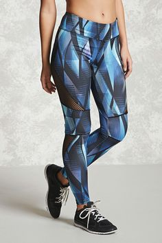 A pair of leggings featuring an allover geo print, mesh panels, hidden key pocket, and an elasticized waistband.