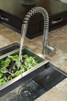 This would be a nice add on, considering the small size of the sink. Or perhaps a sink with a sliding cutting board/drain combination