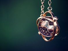 hourglass and orb pendant