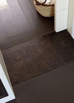 Leather and Upholstery nails floor mat.  Erin Martin Design - Projects