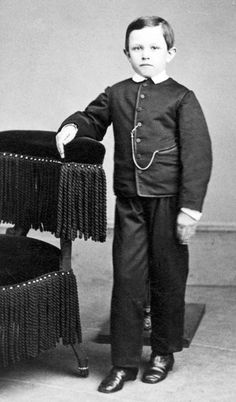 "Thomas ""Tad"" Lincoln Photograph taken in 1862-post mortem notice stand in background holding him up"