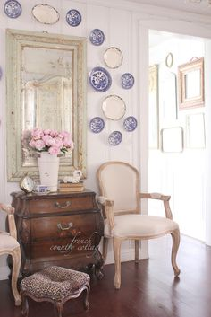 Blue & White plates on wall.