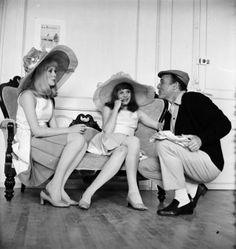 """Sisters Catherine Deneuve,Francoise Dorleac and Gene Kelly in French director Jacques Demy's dance musical """"Les Demoiselles de Rochefort""""."""