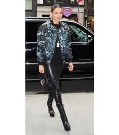 Ciara stepped out in New York recently wearing Joseph Stretch-Leather Leggings, a printed Givenchy bomber jacket and purse, and lace-up Alaia boots.