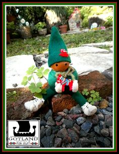 Tiny Tomte (  Swedish gnome) holding   a hand carved and painted Dala horse   ( Dala horse is a Swedish traditional wooden horse). One-of-a-kind, soft  body, dressed in felt and embroidered cap--  https://www.facebook.com/GotlandHeathenStuff -#OOAK_gnome #gnome