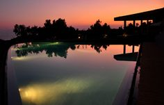 Leivatho Hotel Swimming Pool by night Hotel Swimming Pool, 4 Star Hotels, Front Desk, Hotel Offers, Northern Lights, Greece, River, Sunset, Night