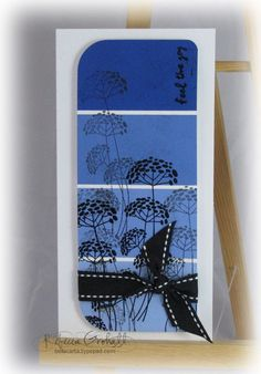 handmade card ... tall and thin ... deep blues ... silhouette flower stamped on top ... lovely ...