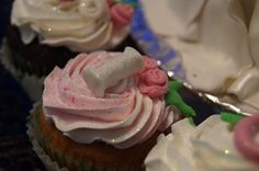Red Velvet cupcake with cream cheese frosting adorned with sparkles and roses <3