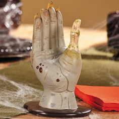 Halloween is coming and your table just would not be complete without one of these Zombie Hand Napkin Holders. It makes it look like a Zombie hand is rising Halloween Make Up, Halloween Themes, Halloween Decorations, Zombie Mask, Zombie Makeup, Zombie Gifts, Zombie Apocolypse, Zombie Attack, Kitchen Themes