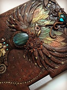 Handcrafted Fairytale Clay Journals by Mandarin Duck Jewelry designer Aniko Kolesnikova, (previously featured here) best known as Mandarin Duck is recognized for her whimsical, sophisticated, ornate. Polymer Clay Kunst, Polymer Clay Projects, Polymer Clay Creations, Polymer Clay Jewelry, Clay Crafts, Leather Art, Leather Books, Theme Harry Potter, Kindle Cover