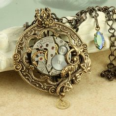 Steampunk Necklace Steampunk Pendant Steampunk Pocketwatch Necklace Brass Filigree Steampunk Gold Gears Necklace Silver Vintage Watch. $65,00, via Etsy.