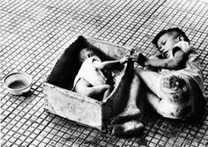 This image brings tears to my eyes every time I see it. My son is 7 and my daughter almost 2, it could be them in a different world. Baby girl, named Tran Thie HetNhanny, lying in a cardboard box next to her brother, who begged on the streets of Saigon. When the photo was published in February of that year, it inspired Americans to raise money to bring the baby to the US to undergo surgery to correct a congenital heart defect