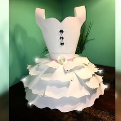 My newest creation.  This paper dress is a perfect addition for the candy/desert table and can also be use as a table centerpiece.  #paperflowers #paperdress #papercrafts #papercraft #partyflowers #nurserydecor #partydecor #babyshower #partyevents #babyshowerdecor #weddingdecor #backdrop #backdropinabox#partyplanner #eventdesigner #wedding#makeitwithmichaels #paperflowersbackdrop #daisyscustomcrafts #handmade #diy #creativedecor #craftdecor #paperflowertemplate #charlottenc #picture...