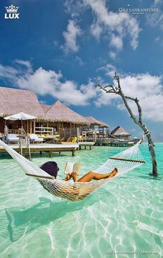 Gili Lankanfushi Maldives. Nestled in tropical gardens, this luxurious resort is on a tranquil, private island in the Laccadive Sea. Featuring natural materials and wood floors, the elegant, over water villas are reached by boardwalks from the island.