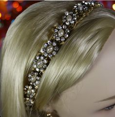 Check out this item in my Etsy shop https://www.etsy.com/listing/255645495/bridal-headpiece-gold-pearl-crystal
