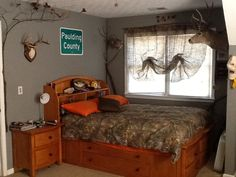 My sons redneck hunting bedroom with camo curtains, treetrunk curtain rod, camo bedspread and tree limbs attached around the room. Redneck Bedroom, Boys Hunting Bedroom, Kids Bedroom, Bedroom Decor, Bedroom Ideas, Hunting Rooms, Hunting Themes, Bedroom Makeovers, Dream Bedroom