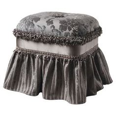 "Highlighted by damask upholstery and a gathered skirt, this sumptuous ottoman elegantly complements your favorite arm chair or vanity stool.  Product: OttomanConstruction Material: Wood and polyesterColor: GrayDimensions: 19"" H x 18"" W x 15.5"" D Note: Assembly requiredCleaning and Care: Dry clean"
