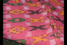 Ikat Weaving Cotton Fabric in Carrot Red, Black, Green and Yellow Color. You can use this fabric to make dresses, tops, Crafting, Drapery, Home Décor, Outdoor, Quilting, Sewing, General, Upholstery...