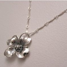 Sterling Silver Dogwood Flower Necklace by RebeccaWeis on Etsy, $25.00 - possible bridesmaid's gift?
