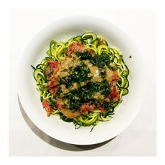 Loving this amazing raw zucchini noodle dish for #meatlessmonday. I just bought a spyra gyra spiraliser and it works so well to create awesome noodle spirals A little extra prep time but so fresh and tasty! You can also buy ready prepared zucchini noodles from woollies but for me fresh is always best Topped my zoodles with tomato relish made with tomatoes fresh garlic thyme oregano rock salt chilli and chopped onion all whizzed up in my blender. Added some almond pesto (basil almonds white…