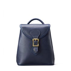The small Legacy Backpack in Navy Leather is the accessory to complete the look.