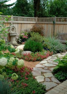 25 Inspirational Backyard Landscaping Ideas. Let's analyze. Spots of color in the corner are just in the pots they came in. The rocks, bench and fountain help soften the blow of Fall.