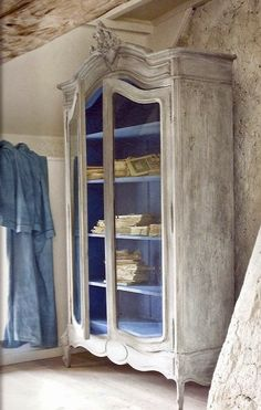 Armoire interior painted with color.