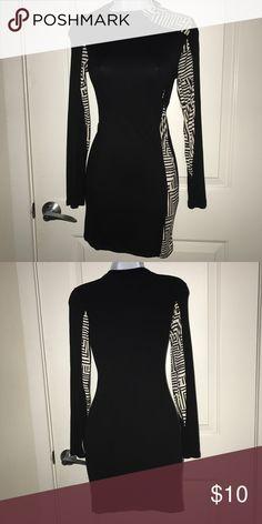 Long sleeve bodycon dress Black and white bodycon long sleeve dress. Size medium. Never worn. NWOT Dresses Mini