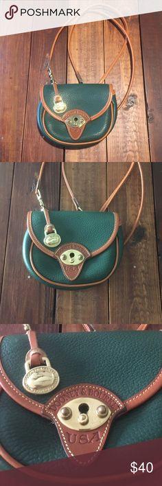 Vintage Dooney and Bourke cross body purse Beautiful vintage green purse in great condition! Dooney & Bourke Bags Crossbody Bags