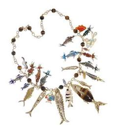 A FISH CHARM NECKLACE  Suspending twenty-five fish charms of various design, the sculpted gold open link neckchain spaced by tiger's eye beads, 29 ins., shows signs of wear, overall condition fair Neckchain signed V.C.A. for Van Cleef & Arpels, no. 4V353-?7 (indistinct); largest fish charm signed V.C.A. for Van Cleef & Arpels, N.Y., $30,000.00