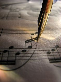 calligraphy pen and music, very pretty shot