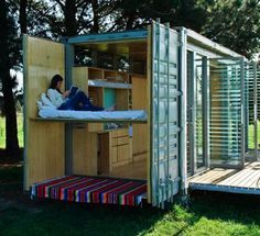 20' shipping container, one side of the container folds down to open it up to the bright outdoors. Every inch is used cleverly, even the container doors become support for a bed. it's portable, secure, inexpensive, comfortably sleeps two adults, two kids. use your land without investing in a permanent property, easy transportation (via truck or helicopter) minimal impact on site, folds up into a standard container, can be shipped worldwide. -- Port-a-Bach Shipping Container home : TreeHugger