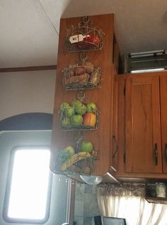 Store fruit, vegetables & produce in the kitchen of a camper, motorhome, travel trailer, tiny home, or small apartment with one of these space saving ideas. #Traveltrailers